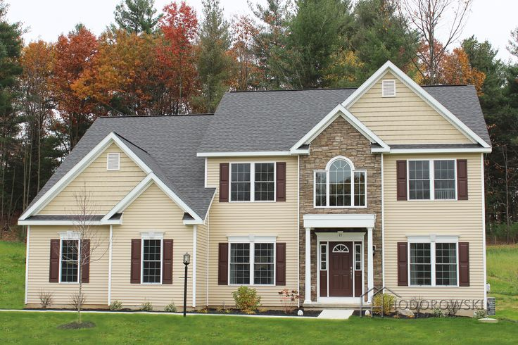 This Country Manor Model House With A Side Load Garage