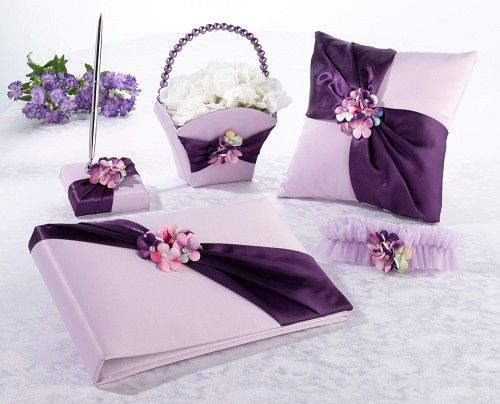 Purple satin accessories set including guest book and pen; ring cushion; flower basket and garter http://www.wedding-giftsonline.co.uk/purple-satin-collection-3889-p.asp