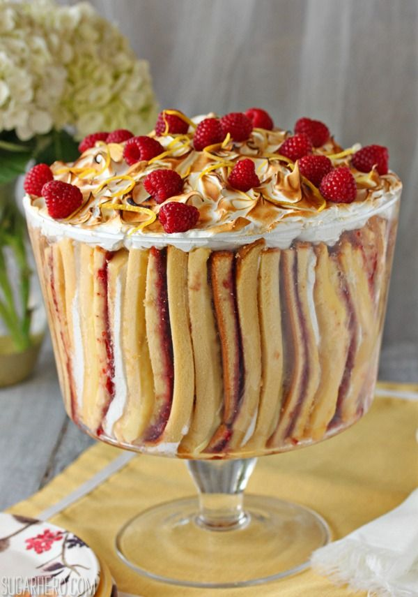 Raspberry Lemon Meringue Trifle - a gorgeous vertical trifle with pound cake, lemon curd, raspberry jam, and meringue.   From SugarHero.com