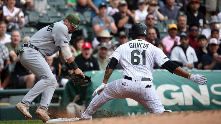 White Sox 7, Tigers 3 -  May 28, 2017:   Detroit Tigers third baseman Nicholas Castellanos can't handle the throw as White Sox left fielder Willy Garcia slides in with a triple, allowing him to score in the third inning.