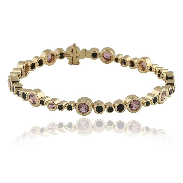 Kielo Bracelet. Glossy 14 karat yellow gold.25 faceted black onyx - 1.73 carat and 16 faceted pink tourmaline - 4.19 carat.