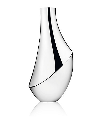 Georg Jensen Vase designed by Newson. Newson has designed for everyone is seems. Just to name a few: Smeg, Furniture for Cappellini, Ikepod watches, Dom Perignon, Samsonite, Tefal, Alessi, Iittala Pentax K-01, Louis Vuitton, Apple Watches, Hennessy's new Cognac, Montblanc M pen, SMeg, Georg Jenson….