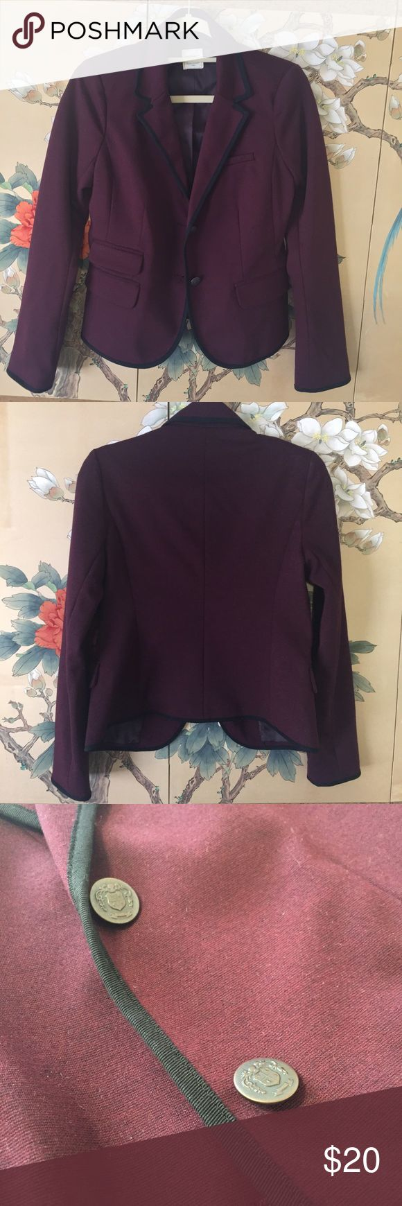 Fitted Gap blazer with black pipping. This fitted blazer from Gap is a rich purple and has black pipping around the edge of the collar and cuffs. Perfect way to incorporate color in your work wardrobe or to wear with jeans and a scarf. Gap Jackets & Coats Blazers