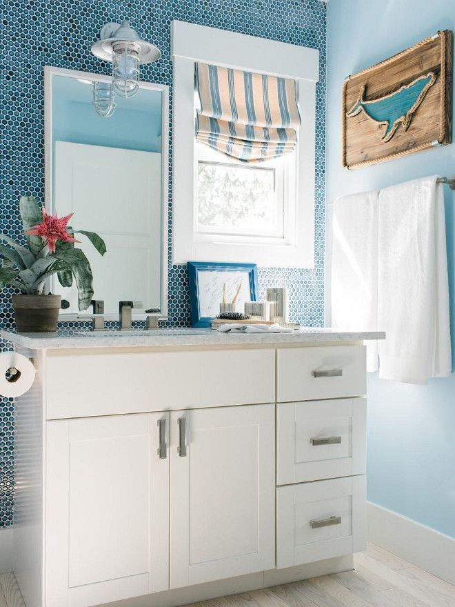 pictures to hang in master bathroom%0A HGTV Dream Home      Terrace Bathroom  Brilliant blue penny tile walls  bring a coastal touch into the bathroom  while a sleek white vanity and  eyecatching