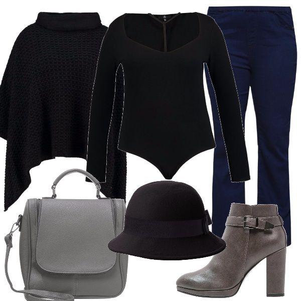 Un paio di jeans bootcut vengono proposti con una maglia nera, da indossare con una mantella in lana a collo alto, sempre nera come il cappellino. Gli accessori sono grigi: gli stivaletti con tacco alto e la borsa a tracolla.