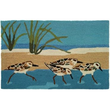 Sandpipers in the marsh diligently looking for their next meal! #coastalrugs #coastalmat