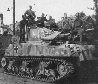 Russian forces pose on a recaptured M4 Sherman that was usw d by German Panzer forces
