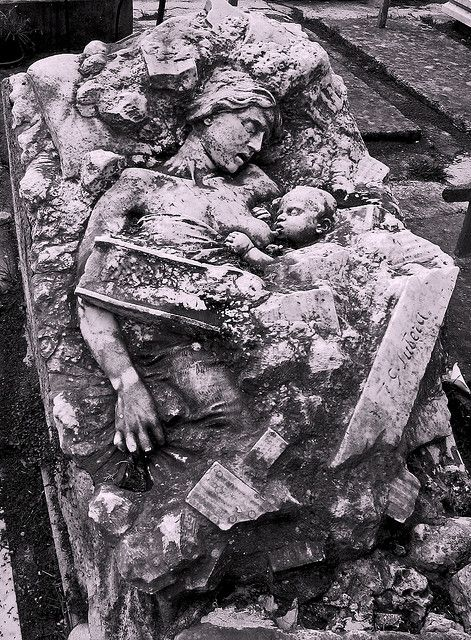 Monument-grave in memory of 2 victims of the earthquake at Messina (Sicily) on 28th day of December, 1908.  This mother and daughter lay sleeping together when the earth began to quiver..