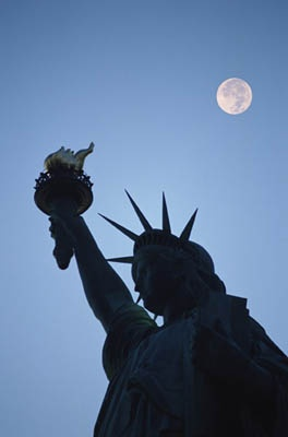 The moon watching the Statue of Liberty