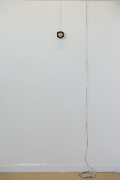 I Sound For You (2015).   Artist: Liza Savage.   Speaker cone, speaker wire and extension cable.  Plays a long, low bell/chime every five minutes. An acknowledgment of a child's life which has been taken by violence.  Child Helpline International statistics.