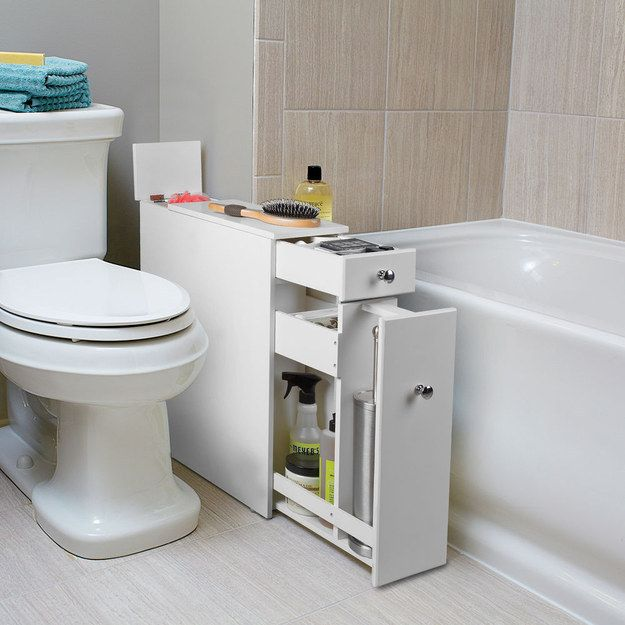 23 Unexpected Things You Didn't Know Your #Bathroom Needed ~ Here: This extra cabinet that fits awkwardly into that awkward space between your toilet and the tub.