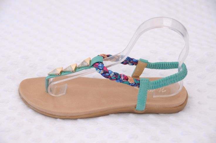 Pair these sassy thong sandals with jeans, 3/4 pants or a pretty Summer dress. Love the Aztec embellishments!