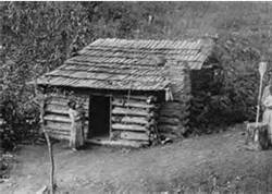 This photo taken in North Carolina in 1888, shows a Cherokee cabin that is very representative of the homes in this region during the 19th century. The United States federal government forced about 16,000 Cherokee and hundreds of other Native Americans to abandon their land in NC, GA, Tenn, & AL and move to OK in the late 1830's. Brett Riggs, an archaeologist at the University of NC, is uncovering the remains of farms and homes in the mountains of NC that the Cherokee left behind.