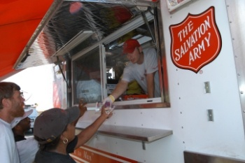 """Often the most recognized aspect of The Salvation Army's disaster work, The Salvation Army provides hot meals, snacks, and drinks to disaster victims and emergency workers. This food may be served at congregate feeding sites, such as an Army corps building, camp, or shelter, or from one of the Army's fleet mobile kitchens, a """"canteen."""""""
