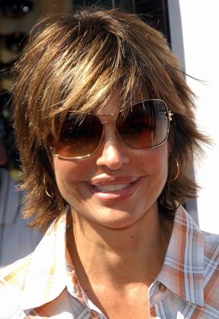 Short Layered Hairstyles Fat Face | Lisa Rinna has short to medium, straight hair in a shag style with a ...