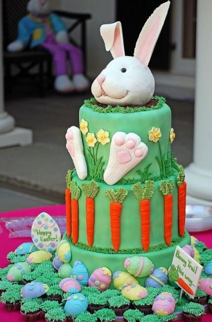 Easter bunny cake with Easter eggs surrounding  this is just a picture of the cake - @Debbi Andersen Jones Beverly should make this for neighborhood Easter egg hunt this year :)