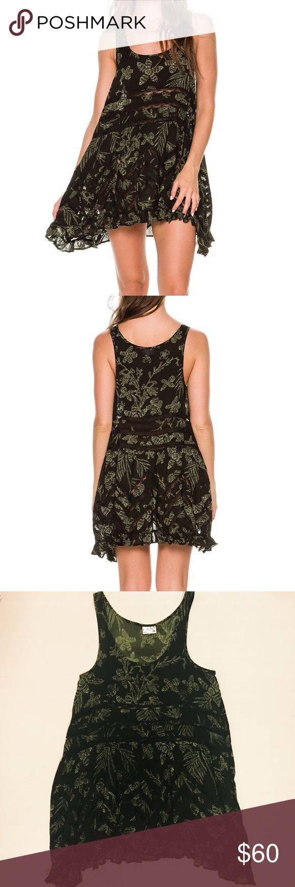 Free People Voile and Lace Trapeze Slip Dress Like new Free People Voile and Lace Trapeze mini dress in black with green leaf palm print throughout. Sheer black with ruffled trim and lace inset. Unlined. 100% Rayon. EUC. Free People Dresses Mini