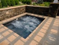 #Summer Granite Pool Paving used around this spa. #StoneCladding has also been used for the surrounding walls