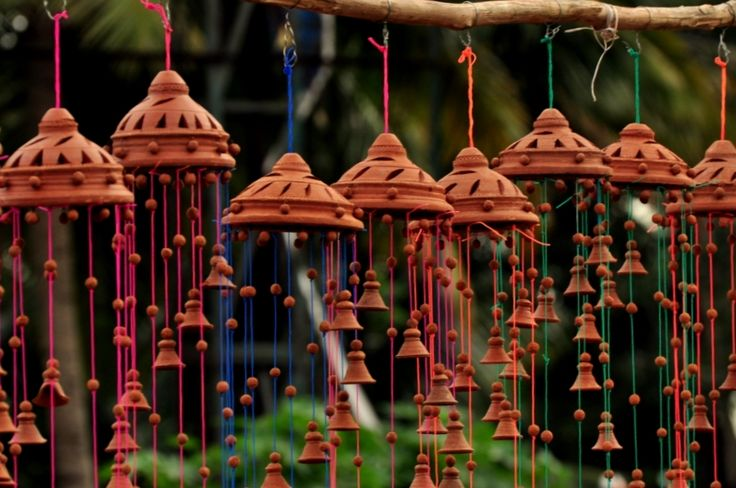 Colorful strings terracota wind chimes - Bangalore, India  http://noisypilgrims.com/2010/11/04/terracotta-wind-chimes/