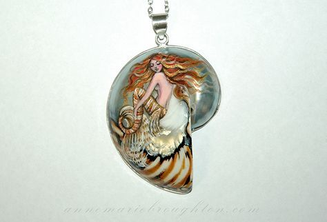 """Tiger Mermaid"" Hand Painted Balinese Nautilus Mermaid Art Pendant Jewelry (2016) RESERVED A stunning redhead mermaid with gold highlights hand painted with super fine brushes on a polished balinese nautilus shell pendant, with sterling silver trim and bail. Inspired by the tropical Lionfish, her striped burnt orange and white tail and spotted flutes echo the tiger stripes in the nautilus shell. Pendant height approximately 6cm not including bail. Sealed with high gloss varnish for…"