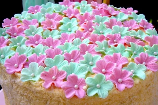 Flower topped cake at a Tea Party! See more party ideas at CatchMyParty.com! #partyideas #teaparty