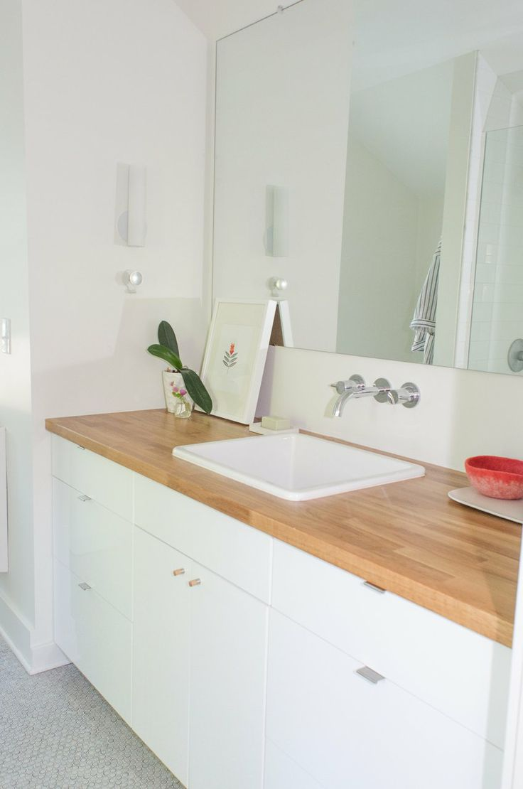 Faith & Mike's Master Bathroom: The Big Reveal Renovation Diary | Apartment Therapy - Ikea kitchen cabinets for the bathroom - practical and cheaper? love it