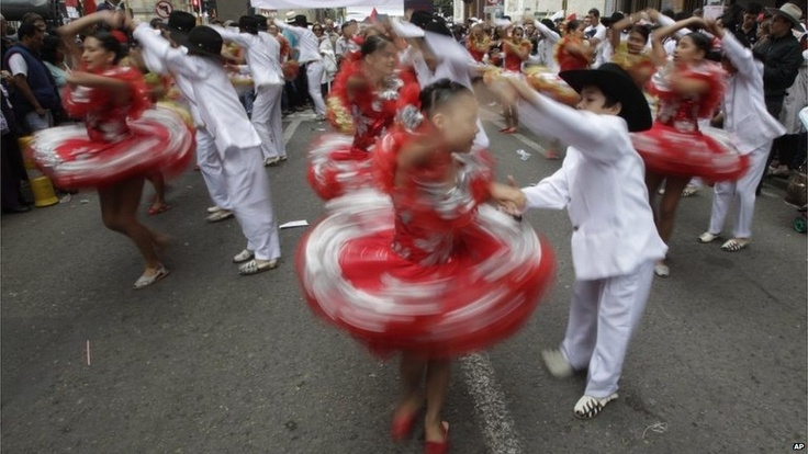 Children dance during a march for peace in the Colombian capital Bogota.