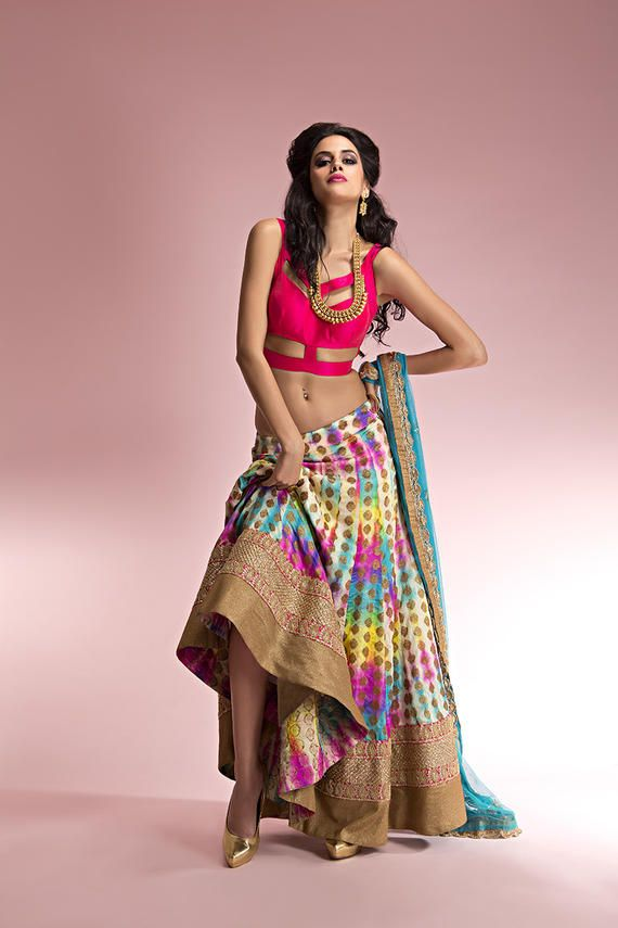 Light Lehenga - Hot Pink and Multi-colored Lehenga | WedMeGood Hot Pink Cut Away Blouses with Multi-colored Lehenga. Gorgeous Mix of Yellow, Teal, Hot Pink and Gold Polka Dots on Lehenga. Find more lehenga designs on wedmegood.com #wedmegood #lehenga #cutaway