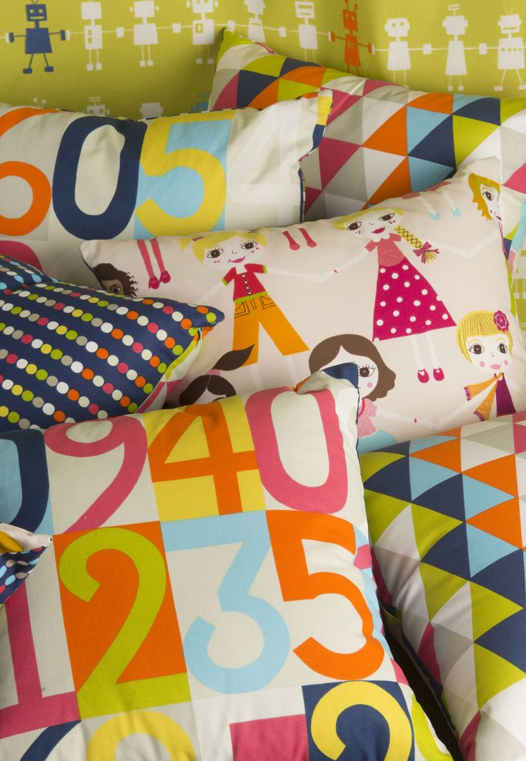 """A selection of fabrics made into cushions from the """"All About Me"""" Collection. www.lahood.co.nz"""