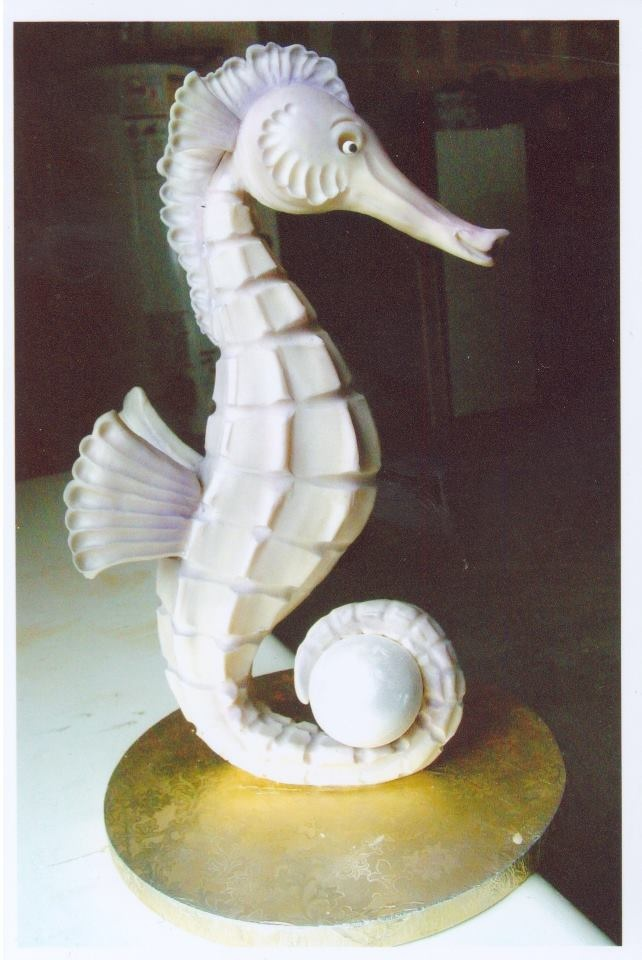Does anyone do better sculpted cakes than Mike McCarey of Mike's Amazing Cakes? The seahorse is made of modeling chocolate, the only part that is cake is the pearl tucked inside the tail. Brilliant!