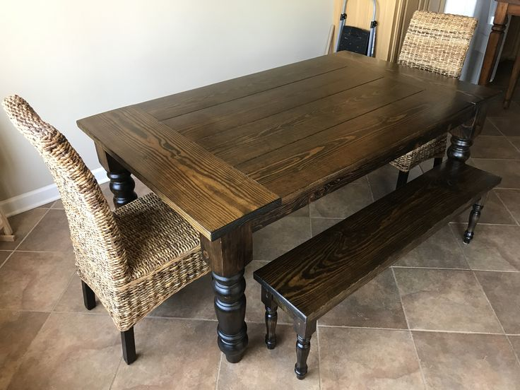"This 6' x 42"" Baluster Turned Leg Table features a Traditional Top with Endcaps in Dark Walnut Stain with a Satin Finish. Photographed by our Delivery Team with two Natural Finish Banana Leaf Chairs and a matching Dianne Bench.  Dining Room, Guest House, Solid Wood, Made in the USA, Craftsman Table, Farmhouse, Rustic, Family Meals, Home"