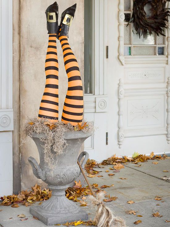We love this cute witch legs urn! More witch decorations: www.bhg.com/halloween/decorating/witch-decor-for-halloween/?socsrc=bhgpin102612witchlegs#page=4