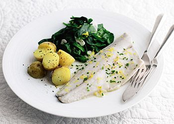 sea bass with lemon potatoes and garlic spinach