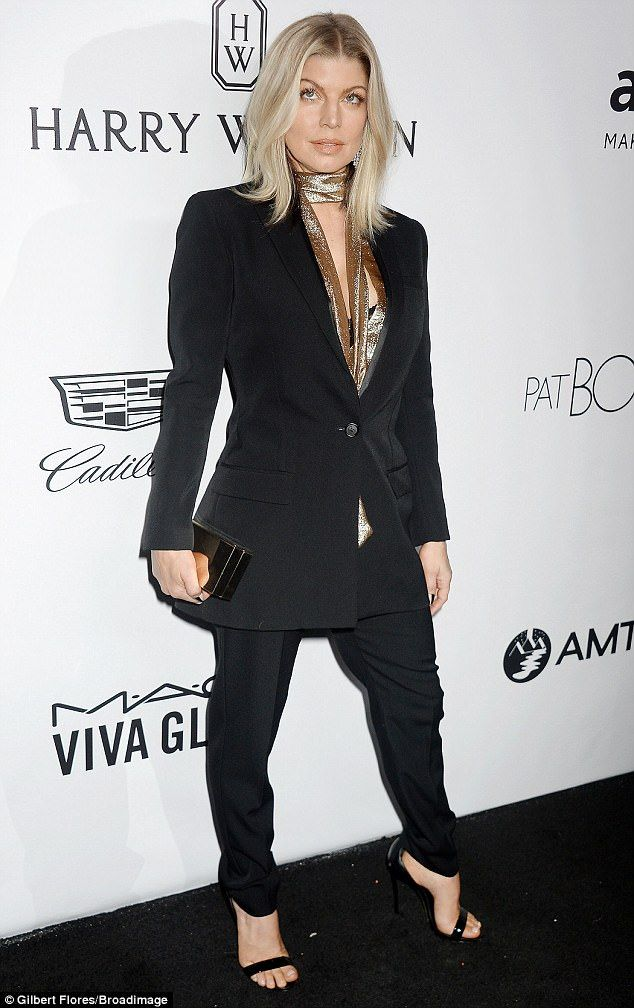 Glamorous: Fergie, 42, rocked a matching blazer and trousers combination with no shirt underneath