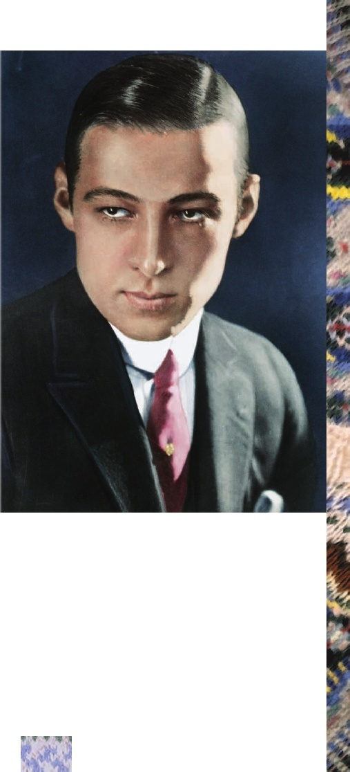 """""""The smoldering Rudolph Valentino exploited his Italian goodlooks, becoming known as """"theLatin Lover."""" Note the jeweled tiepin and unusual pink tie."""""""