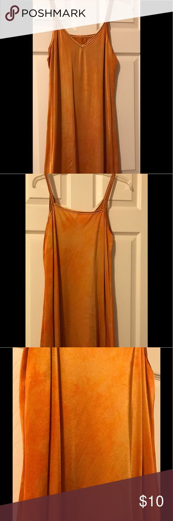 Orangish gold underslip This underslip is great worn under a see-thru or lace tunic. It was originally a 'nude' color but after my mother-in-law thought I was indeed nude under my lace dress, I dyed it orange!  It came out with a cool tie dyed effect. Vanity Fair.  Intimates & Sleepwear Chemises & Slips