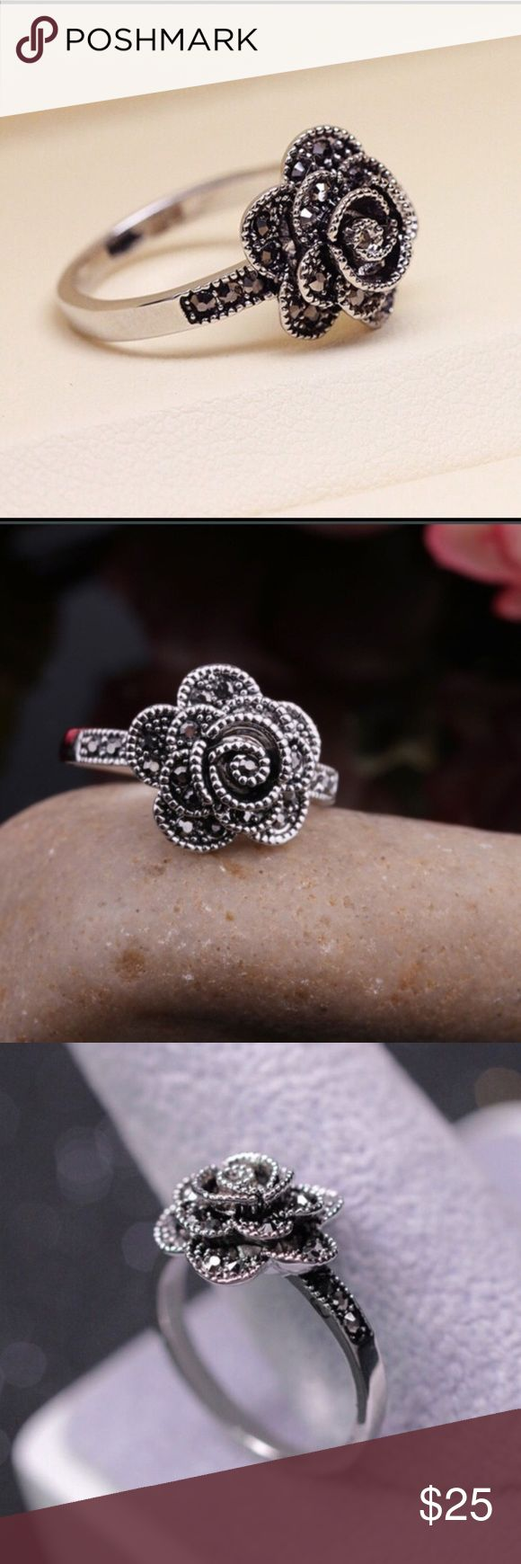 Marcasite Rose Ring Such a beautiful shiny marcasite ring! Rose design with tiny black stones. Never worn, brand new! Jewelry Rings