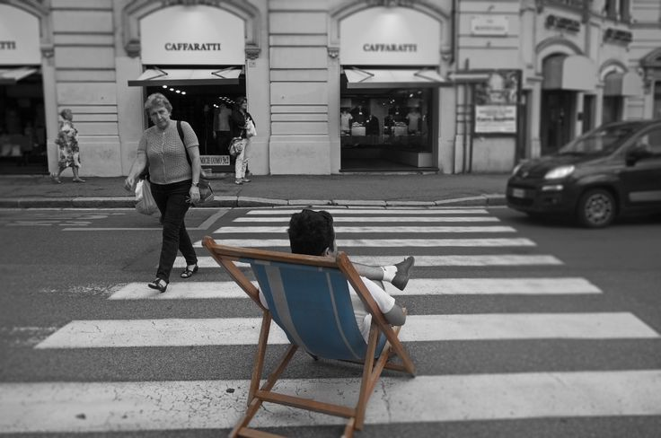 relaxing in the street, genoa, italy