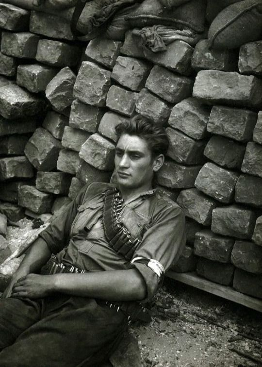 Exhausted French Resistance fighter, Paris, 1944.  They were all so very young and were all so very old once the war ended in 1944...all seen on their faces and in their eyes....