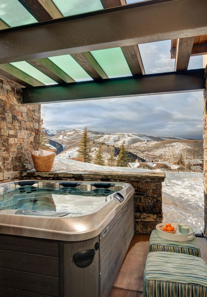 rustic hot tub with stone wall high in one side and half wall in front, glass ceiling of Marking Your Private Space, Enjoying Your Time in Hot Tub