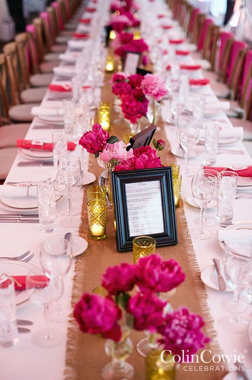 The large peonies are extremely captivating and romantic, especially when surrounded by candles. Low Centerpieces, Wedding tabletop, Flowers || Colin Cowie Weddings