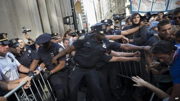 Protestors and police wrestle near a barricade on the corner of Wall Street and Broadway during a march demanding action on climate change and corporate greed  on Monday (22 September 2014)Everywhere World News World Leader Joy Richard  Preuss World Leader Powerful  Micro Computer