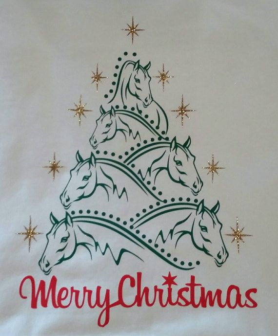 Perfect shirt for the horse lover. Beautiful Christmas Tree with horses. Glitter stars surround the horses. Merry Christmas. Shown on a white t-shirt. This design looks best on a lighter colored shirt. Your choice of White or Heather Grey unisex cotton short sleeve t-shirt Unisex fit See size chart on spec sheet with photos. We use a professional grade heat transfer vinyl that is applied using a professional heat press. Very durable vinyl that will stand up with normal wear, washing and…