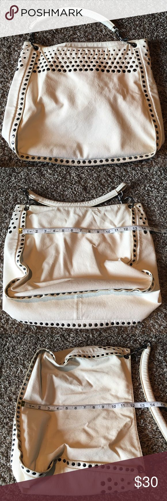 White studded Melie Bianco purse 13.5x12x4 Great condition! Only flaw is last picture: one very tiny unnoticeable hole/tear on back side. smoke free. 🛍Open to reasonable offers ONLY please! I will not consider unreasonable offers that are half the asking price. No trades. No Modeling. And please keep in mind Poshmark sets the $6.49 flat rate shipping. Thank you!☺ Melie Bianco Bags Shoulder Bags