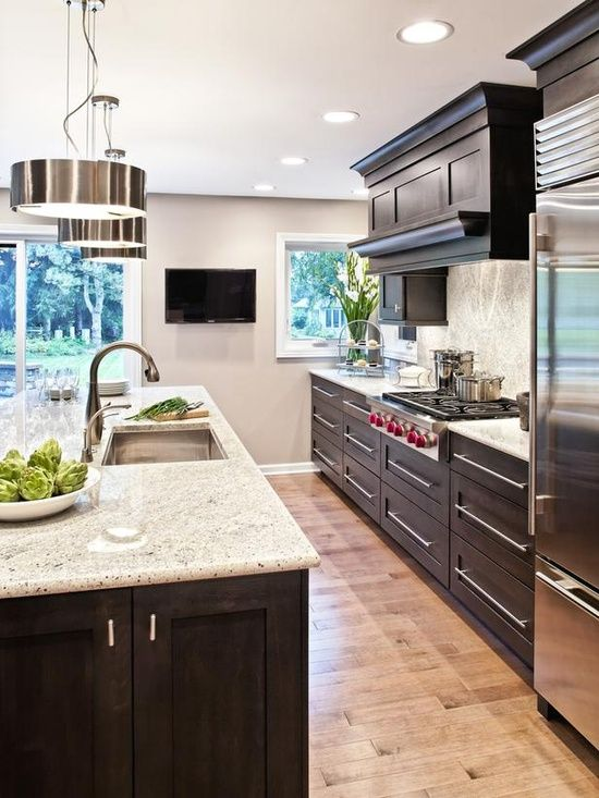 I like the modern turn this kitchen takes. I like modern design, in fact, better than traditional, but I wonder how it would fit in my traditional house built in the 1960s. ... dark+cabinets+with+light+countertops | ... Contemporary | Kitchens | Dark cabinets w/ Light countertop and floor