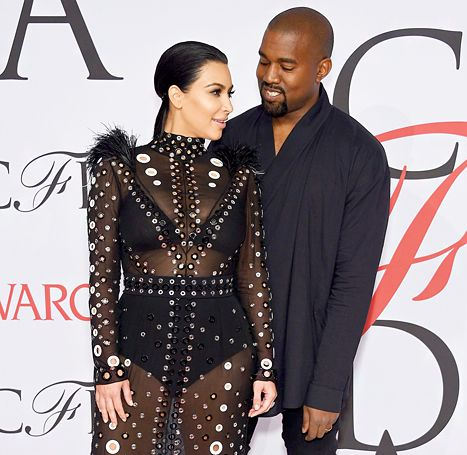 Kim Kardashian and Kanye West attend the 2015 CFDA Fashion Awards