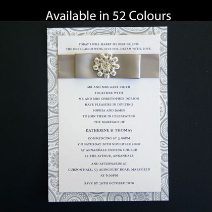 These two layer wedding invitations are shown here with a gray paisley backing layer. They include ribbon an a bling style embellishment. Available in more than 50 colours. www.kardella.com