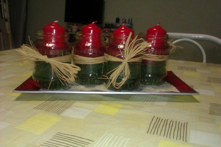 """I made this christmas """"wreath"""" last year, these are """"mason"""" jars, with pine in the bottom :)"""