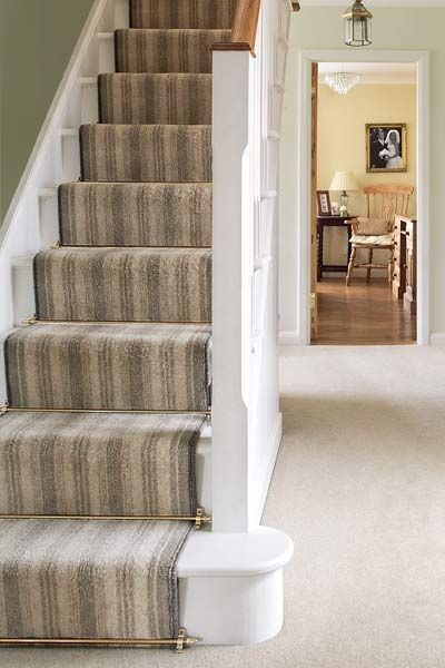 easy thrifty vintage charm update stair carpet runner.  Ok, so I'm intrigued by the rods.  Can't help it.  Might be a viable option.
