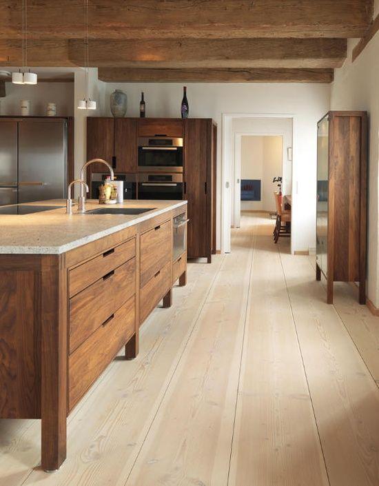 sleek + wood + floors +exposed beams